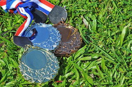 gold, silver and bronze medals symbolising achievement of three social media goals
