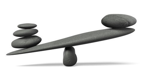 picture of rocks balancing like scales with one side weighted down - symbolising comparison