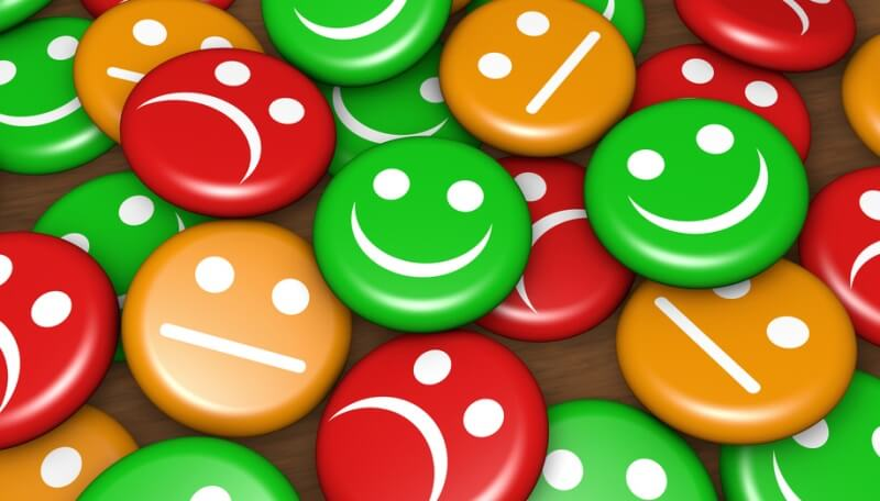 collection of 'smiley' buttons - green smiles, red frowns and orange undecided