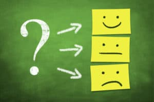 Question mark with happy, sad and neutral faces