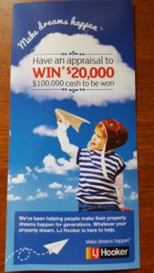 Front text of a real estate marketing flyer with offer to win $20K