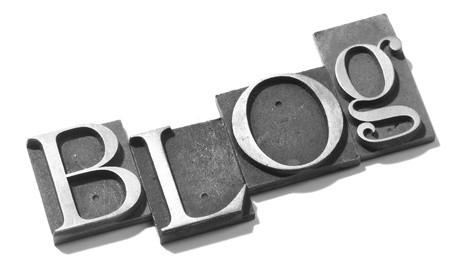 letter printing blocks making the word 'blog'