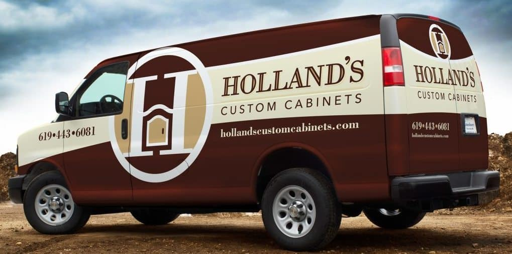 photo of van with signage showing website of Holland's custom cabinets