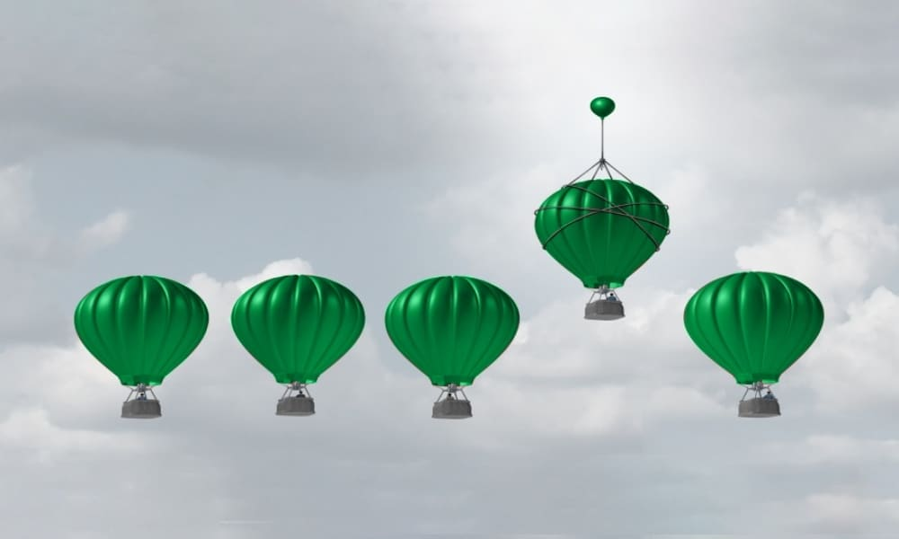 one hot air balloon flying higher than others - smart winning in marketing