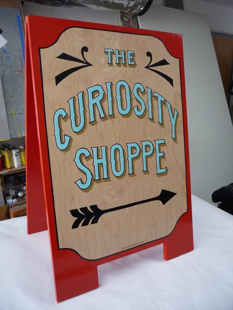 curiosity-shop-signage-for-customer-awareness